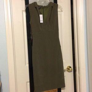 Dark olive green Bebe dress. Never worn. Too small